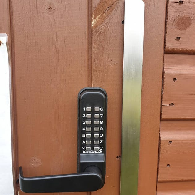 Marine grade Codelock fitted to this outbuilding with anti-thrust plate for added security - external